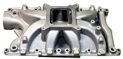 A single-plane manifold is often preferred for 600 hp or more. This Summit Racing Street and Strip Stage 4 manifold provides gains in the 3,500- to 7,500-rpm range. This is more of a strip/track-oriented manifold in that it has four ports for coolant temperature sensors (two in front, two on the rear coolant crossover), cast-in bosses for nitrous nozzles or fuel injectors, and a larger, more-open plenum. The runners are separated from the manifold floor to keep the intake mix cooler. (Photo Courtesy Summit Racing)