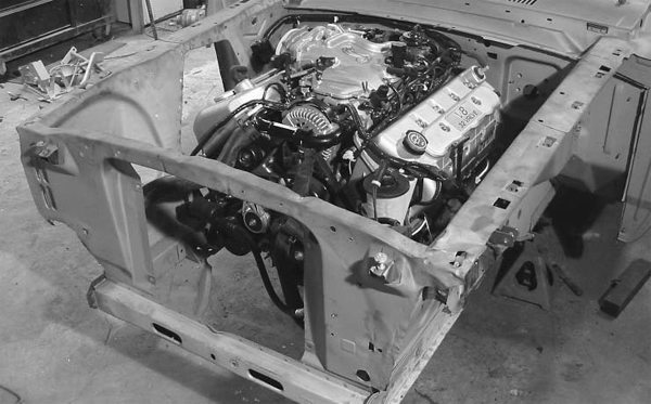 Just because a car didn't come from the factory with a certain engine as an option doesn't mean you can't make the swap. Probably the most labor-intensive engine swap is putting a 4.6- or 5.4-liter Modular engine into a shock-tower-equipped Restomod, because the shock towers have to be modified. (Photo courtesy The Mustang Shop)