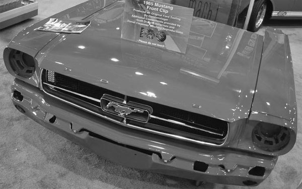 Reproduction parts are not all created equal. This '65 Mustang front clip is built from reproduction parts from Scott Drake Enterprises. These are produced from original Ford tooling. Mustangs Plus is just one of many dealers that sell Scott Drake Enterprises parts.