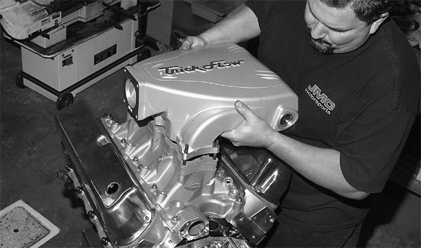John lowers the Trick Flow upper intake manifold in place.