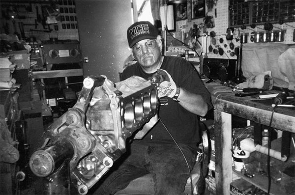 Here, Benton Jackson works a 302 block, getting it ready for a made-toorder stroker package. Benton's area of expertise is induction systems. Each engine is hand-built. No mass-production thinking here.