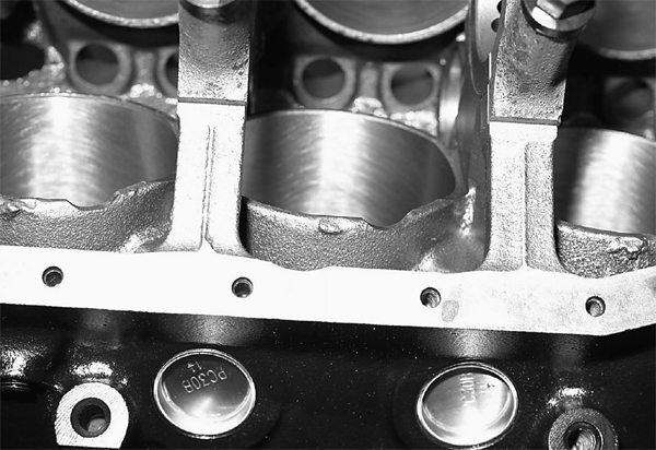 Our foundation is a 5.0L engine block from Summit Racing Equipment. John has inspected and worked this block to the plan, including notching the cylinder skirts to clear the connecting-rod bolts.