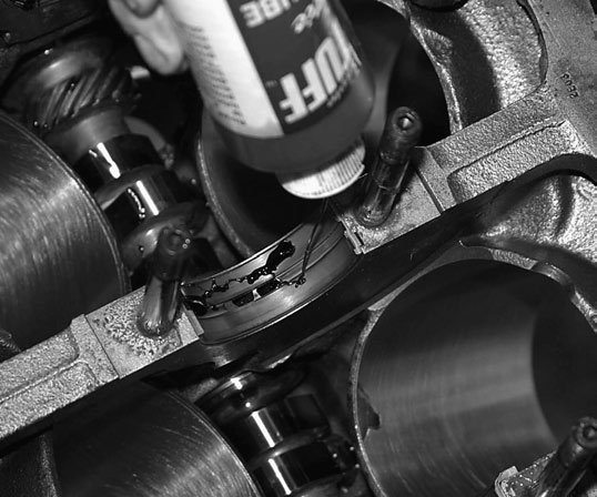John uses plenty of assembly lube on main and connecting-rod bearings. This gives the journals something slippery to ride on for that first firing. If the engine sits for any length of time, assembly lube gives bearings and journals a fighting chance at life.