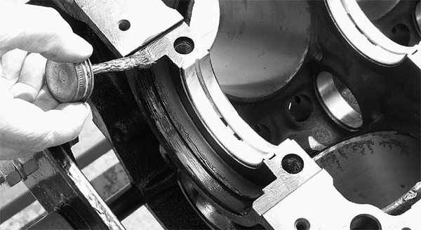 The one-piece rear-main seal groove gets a light application of gasket sealer where the seal will seat.