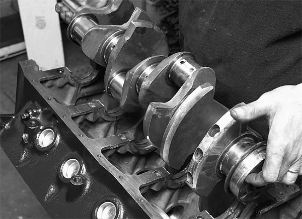 The new Speed-O-Motive nodular iron custom crankshaft is laid in the block as shown. It spins easily, indicating a good fit.