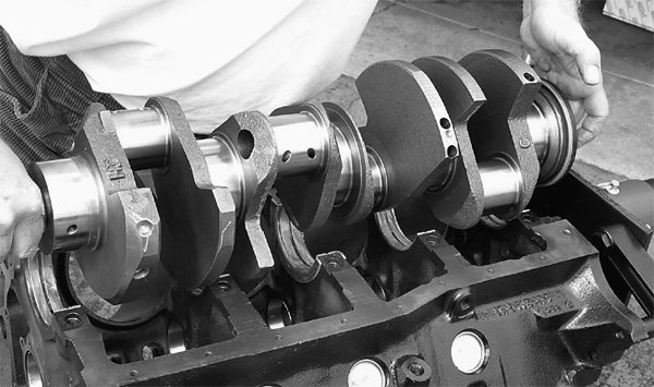 The high-nodular iron custom crankshaft from Trans Am Racing is laid in the block as shown. Mark will check the crank for freedom of rotation.