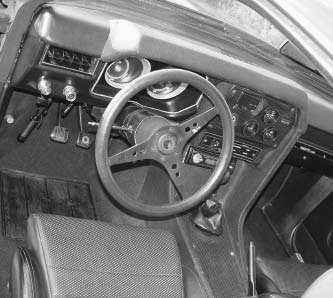 This mostly stock Pangra received suspension upgrades, and the interior was modified too. The car had a custom console and dash, aftermarket gauges, and Recaro seats.