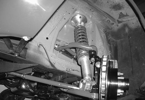 Global West offers upper and lower tubular control arms with its Category5 coil-over kit (shown here). The kit requires the installer to drill a few holes in the shock tower, so Global West includes quality metal templates and detailed instructions. (Photo courtesy Global West Suspension Systems)
