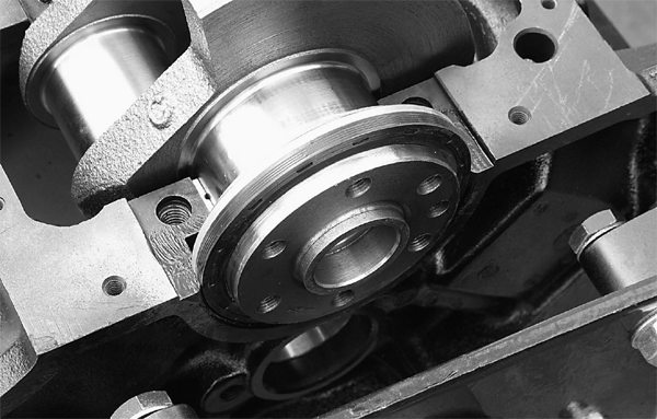 The one-piece rear-main seal has been a nice upgrade for smallblock Fords since the mid-1980s. It is less prone to leakage and is easy to install. Mark went the extra mile by applying sealer between the seal and block to further prevent leakage.