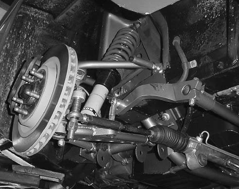 Griggs Racing coil-over front kit totally relocates all suspension pivot points and features weld-in uppercontrol-arm mounts and a lower K-member. The new steering rack mounts in front of the spindle centerline and uses a racing-style sway bar. (Photo Courtesy Mustang Don's)