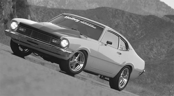 Derrick Yee is a big fan of the Ford Maverick. As you can see, his passion for them is shown by this great example of an unique Restomod. The lack of bumper guards and the prominent carbon fiber hood give this Maverick a powerful look. The Mav' has a great stance: Not too low, not too high. It has great ground clearance for added drivability, and looks right at home on this mountain road. The smoked taillight lenses and barely visible stainless exhaust tips work well together. (Photo s courtesy Phil Royle)