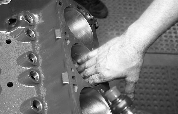 Cylinder walls are wiped clean and lubricated with SAE 30- weight engine oil.