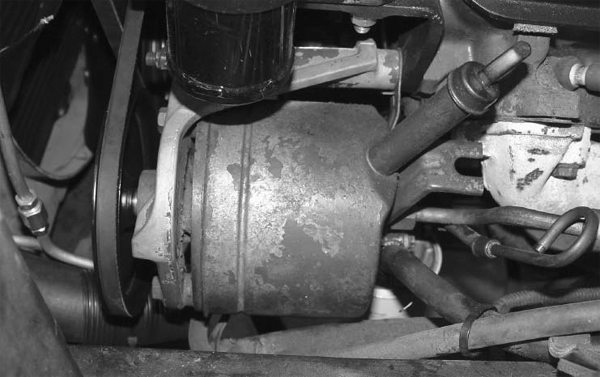 """This is a Thompson """"Slipper"""" power steering pump. The name comes from the design of the internal slipper pistons. If you're planning on periodically running 20-minute sessions at your local road course, you might want to think about upgrading to a new-style pump."""
