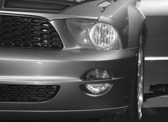 Lighting cues can be picked up from new cars. This nice split turn signal and driving light combination was worn by the 2005 Mustang Concept show car. This cool idea didn't make it to the production Mustang.