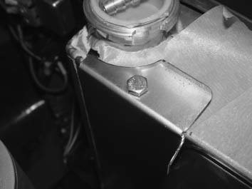 4. The radiator cap was in the way, so I used a set of hand shears to trim the panel and a small file to shape the edge to the correct radius. Riv-nuts were added to the top and bottom panels of the radiator. A single bolt on the top and bottom is plenty to hold the panels in place.