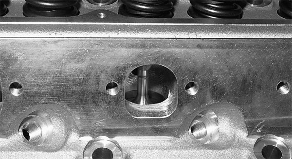 John is opting for the AFR 185 cylinder head for his 331 stroker build-up. This is a great street/strip cylinder head, with its 2.02/1.60- inch valves. D-shaped exhaust ports provide a smoother exit for hot gasses. Good bang for the buck going on here.