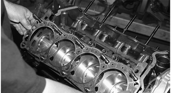 ARP head studs have been installed. John opted for studs because he wants to supercharge this engine eventually. SCE has provided the gaskets for this build-up. After checking the deck and cylinder head surfaces for scoring or debris, John is ready for the AFR-185 heads.