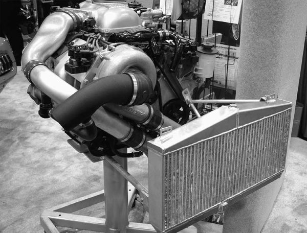 This is a Paxton centrifugal supercharger and intercooler kit for a 4.6-liter DOHC Cobra engine. As long as you're swapping in an engine like this, you might as well go for a blower too, right?