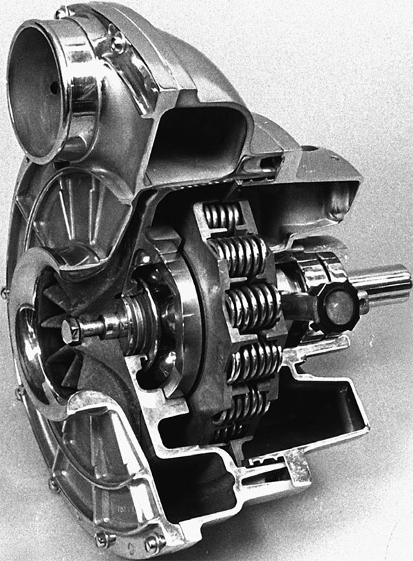 This is a cutaway of a Paxton supercharger. Air is drawn in through the intake at the center of the impeller and thrust outward through a pressure housing to an outlet and tubing.