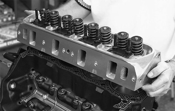 Mark installs the Edelbrock Performer RPM heads, which will allow our 408 to breathe nicely in the RPM ranges it will be operating. Were we building a 408 for street/strip performance or allout racing, we would opt for Edelbrock Victor Jr. heads instead.