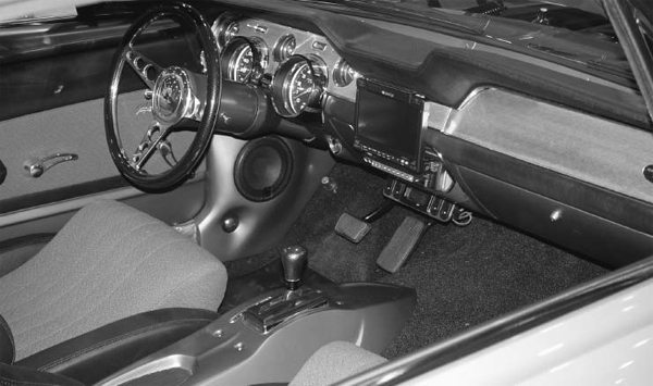 This interior may look familiar to some. It's the Rad Rides by Troy-built EBay Mustang. The custom center console, stereo, and video system are just a few items that were integrated effectively.