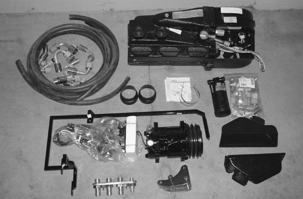 """This is not a system you can order as one part number. Working closely with Kyle Tucker of Detroit Speed & Engineering, I was able to order all the Vintage Air parts to piece together a kit that would be more powerful than Vintage Air's Sure Fit kit. It meant a lot of extra install time, but it was well worth it. The parts necessary for the install were: Gen II Compac evaporator, drier with trinary switch, compressor, bulkhead fitting, condenser, block-off plate (not shown), hose kit, and control panel. The Gen II Series features fully electronic servomotor operation that eliminates reliance on engine vacuum or original control cables. The Gen II also utilizes an adjustable heater control valve to give you that """"just right"""" temperature year-round."""