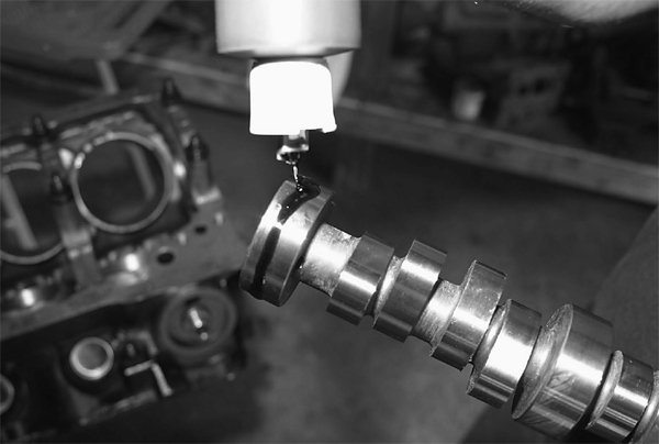 Our Trick Flow roller hydraulic camshaft is lubed and installed. Valve overlap makes this camshaft nitrous-friendly.