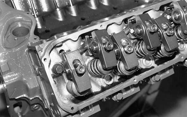 This is a 351C head with screw-in rockerarm studs, and adjustable, aftermarket roller-tip rocker arms.