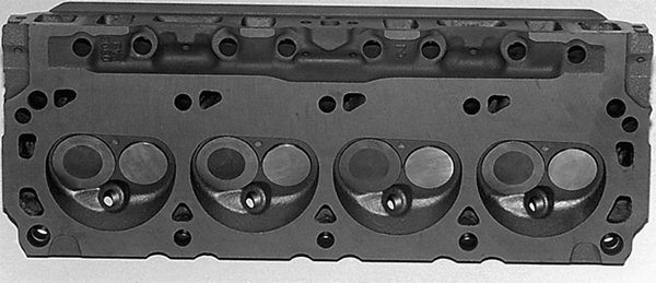 Small-block Ford heads after 1973 had larger chambers for reduced compression. They also have hardened exhaust valve seats for use with unleaded fuels. From 1975-up, these heads have smaller 14mm spark plugs.