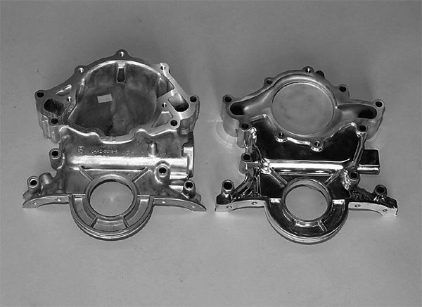 Before we install the timing cover, it is important for us to explain the differences. Shown here are two small-block timing covers. On the left is a vintage timing cover designed for conventional water pumps and mechanical fuel pumps. On the right is a late-model 5.0L timing cover designed for a reverse-rotation water pump and an electric fuel pump. Note the different water pump design and shape (right). The small, monkey-ear water pump is the reverse-rotation design. None of this interchanges.