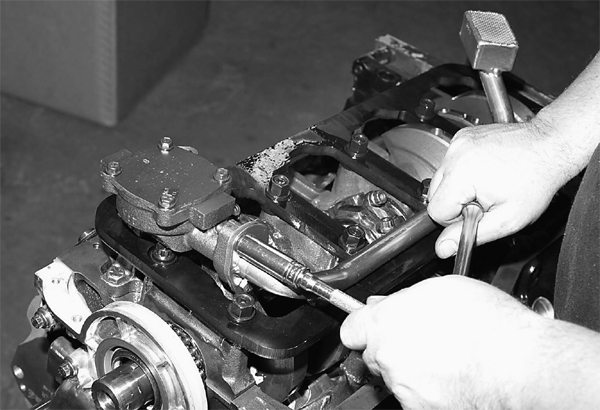 John installs the oil pump pick-up, taking extra care to ensure proper fit. This is the Fox-body, double-sump design, with the pick-up at the rear.
