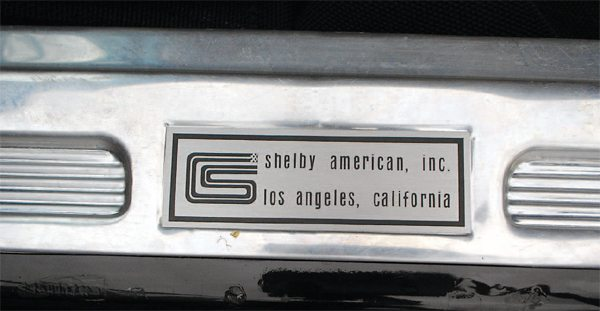 For 1966, GT350s had a unique Shelby American door-sill label that replaced the standard Ford Blue Oval labels, which were actually printed in black. Earlier labels (left) featured the CS logo and a single line of text, with later labels (right) adding the place of manufacture.