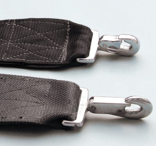 Both manufacturers' belts were virtually identical, with chrome-plated steel hardware being used across-the-board. In the absence of a manufacturer's tag, Ray Brown belts can usually be identified by short attachment hooks at the floor end of the belt; Impact belts had longer hooks.