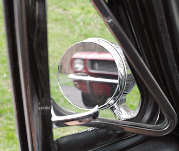 For reasons unknown, Shelby specified placement of the mirror farther forward on the door than the standard Mustang mirror, which necessitated viewing through the vent window. While this led to something of a less-than-perfect view—especially through a rain-splattered vent window—it was far better than on most 1965 Shelbys, which had no mirror at all.