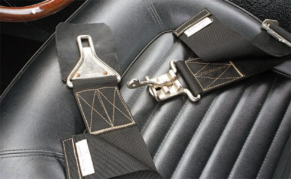 The Mustang's standard seat belts were omitted at the assembly plant, and were replaced at and by Shelby American with hefty 3-inch-wide competition belts manufactured by Ray Brown Automotive. The belt's hardware was chrome-plated steel.