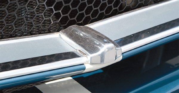 """Deletion from the GT350's grille opening of the chrome Mustang horse emblem and what has, over the years, come to be called the """"corral"""" did, however, mandate one addition with no corral: a polished, cast-aluminum Shelby-unique filler piece covered a gap between the lower grille opening trim pieces, which was normally covered by the lower vertical support of the corral"""