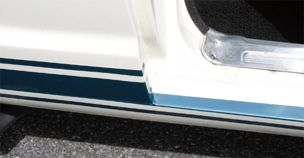 With the side stripe extending below the bottom edge of the door on to the rocker panel, some careful masking was needed to ensure a neat appearance on the door sill, which translated into a time consuming and, therefore, costly process. This problem went away in 1966 and later years with the advent of all-tape side stripes.
