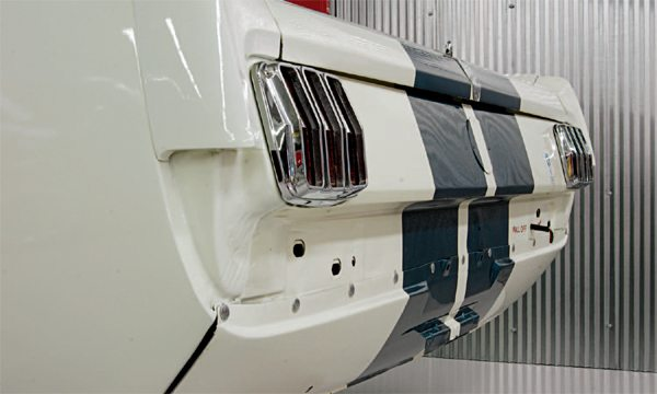 The empty bumper cove and unfilled bumper bolt holes are iconic R-Model identification features.