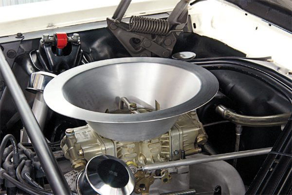 """No chrome HiPo air cleaner here. The R-Model used a spun aluminum plenum bowl to direct cool air into the carburetor. The top of the bucket was positioned under the """"porthole"""" opening in the fiberglass hood, creating something of a ram-air induction setup."""