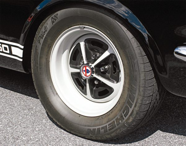 Right around the first of the year in 1966, 14-inch Motor Rim Magnum 500 wheels began arriving at Shelby American. The gray-painted wheel became the new standard wheel, replacing the old Argentpainted 14-inch steel wheel. The Magnum presented a much better appearance and was more befitting the exclusive car that the GT350 was.