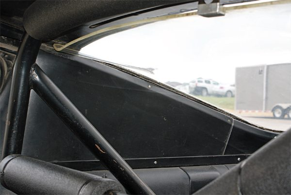 Lacking the characteristic roof louvers of the street GT350, the R-Model interiors used specially-molded blank sail panels, instead of the louvered inside trim panels of the street cars. The small separate panel below the belt molding covers the seat latch, which was deleted on all 1965 GT350s.