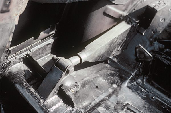 "It is not exactly certain when it was introduced, but later override-equipped 1966 cars feature traction bar sealing fashioned from a Ford truck rubber boot. This replaced the earlier flat rubber seals and fiberglass sealing boxes and was used until the discontinuance of override bars. Later override bars had a slight ""S"" shape to them so that the axle and the floor mounts could be mounted off-line (to each other) to prevent bolt contact with the car's main frame."