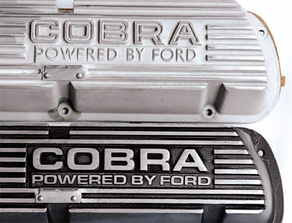 The lettering on the die-cast valve cover was simpler than the older Buddy Bars and because of the differences in lettering styles, the two types of valve covers are often referred to as open-letter and solid-letter types.