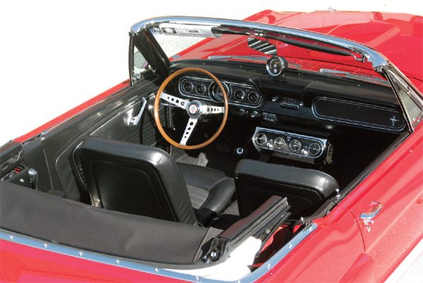 The cockpits of the four experimental convertible GT350s were basically stock-spec 1966 GT350s (two with 4-speed transmissions and two with automatics) except for the addition of Ford air conditioners, which were considered a real luxury, especially in a convertible, in 1966. The car also carries a Shelby American OTC real wood steering wheel, which was installed at birth, as it was on the other three ragtop GT350s. (Photo Courtesy Mark Schwartz)