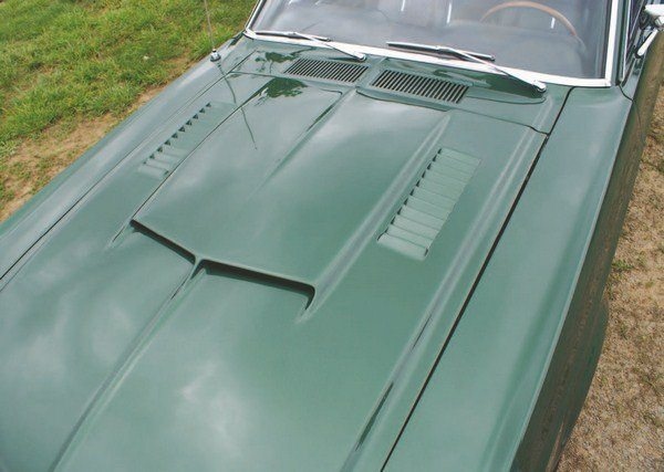 The air scoop on the 1967 Shelby hood was wider and more smoothly integrated into the hood than in years before. Two types of hoods were used in 1967 production: earlier cars had fiberglass-skinned hoods bonded to metal Ford Mustang frames, while later cars had all-fiberglass hoods. Both hoods were visually identical. Louvers were originally planned for air conditioned cars, although hoods with them were ultimately random.