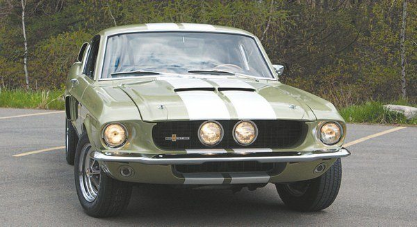 "The two center-mounted headlights nestled within the long fiberglass nose is something of an iconic feature for the 1967 Shelby, it created headaches for Shelby American. Unknown to the California car builder, some states had ""minimum distance between headlight"" laws that the close-together lights violated. Some inboard headlight cars that already were at dealers in those states had the lights relocated to the outboard position (although it seems that those laws were relaxed later in the year as some inboard light cars continued to be shipped to those states, with no record of them having been changed once they got there)."