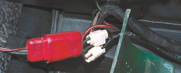The white solderless Scotch-Loc wire splices were used to separate the Mustang's two headlight system into the Shelby's four, but the added resistance caused by the additional wiring yardage (coupled with an occasional imperfect wire splice) often overtaxed the Mustang's headlight switch circuit breaker. A common dealer fix either incorporated a relay into the high-beam circuit or swapped a Cougar headlight switch in place of the Mustang's, which did a better job of handling the increased current draw.