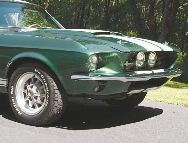 Simple geometry teamed up with the stretched nose of the 1967 Shelby to cause some engineering headaches. Extending the naturally sloping hood and fenders led to necessarily smaller space for the headlights, a problem that was solved by a trip to the parts bin. The 1960 Galaxie headlights (four of them in place of the Mustang's usual two) fit the elongated fenders and grille nicely