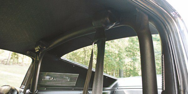 The 1967 Shelby introduced a never-before seen feature on street hardtop cars—an integral roll bar. Welded to the floor pan and bolted to the seat belt anchors in the roof, the bar was a convenient attachment point for a pair of inertia-reel shoulder harness retractors, also a first on any American car. Some early roll bars also had two aft-facing braces that bolted to the car's rear wheel houses, concealed within the interior trim panels. Early bars were wrapped in a soft rubber covering, while the later bars had the rubber coating applied via a dip process.
