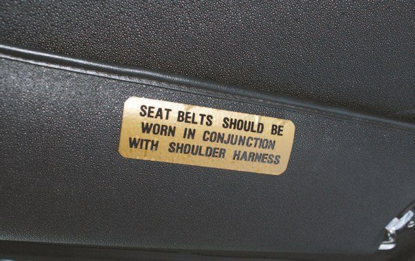 Front seat occupants were warned (via a decal affixed to the bottom of both sides' sun visors) that it wasn't recommended to use just the shoulder belt without the lap strap. The same decal continued to be glued to the sun visors for as long as there were Shelby Mustangs with shoulder harnesses.